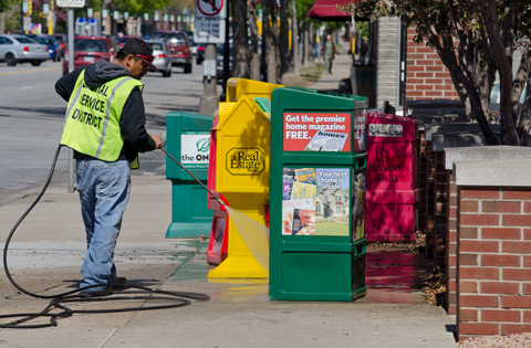 Service District Crews Pressure Washing Around Newspaper Racks in the Lowry Hill District
